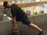 trainer working out with kettle bell
