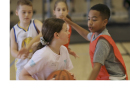 Kids playing a basketball game during Cooper Basketball Camp