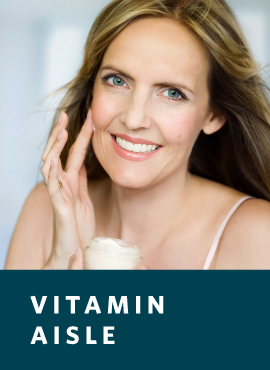 Woman applying anti-aging cream to face