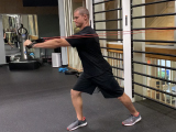trainer performing power training move with resistance band