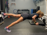 trainer doing pushup on incline