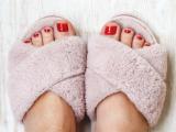 pedicure feet in slippers