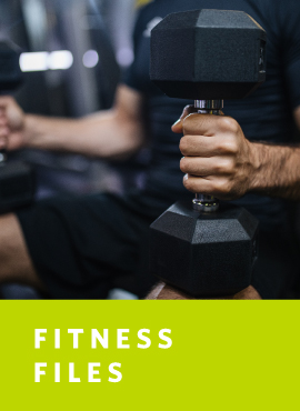 man with dumbbells on knees