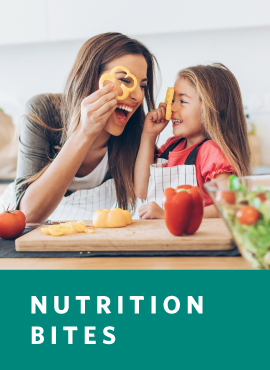 mother and child cooking with healthy food