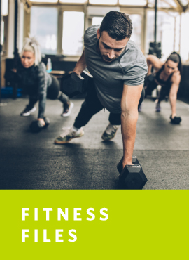 group of people working out with dumbells