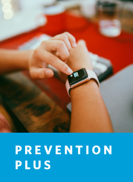 woman checking smart watch on wrist