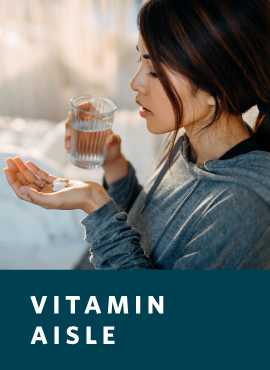 woman taking vitamin with water
