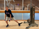 trainer doing cable side lunge